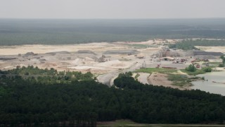 AX71_119 - 5K stock footage aerial video flying by a quarry in Forked River, New Jersey