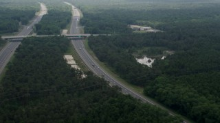 AX71_126 - 5K stock footage aerial video of the Garden State Parkway cutting through Pine Barrens, New Jersey