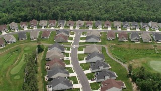 AX71_129 - 5K stock footage aerial video of a suburban neighborhood and a golf course, New Jersey