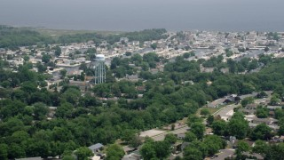 AX71_130 - 5K stock footage aerial video of homes and water tower by canals in Waretown, New Jersey