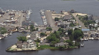 AX71_132 - 5K stock footage aerial video of Mariner's Marina and waterfront homes in Barnegat Township, New Jersey
