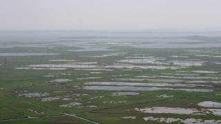 AX71_136 - 5K stock footage aerial video flying over marshland to approach poles and tide ponds in Ocean County, New Jersey