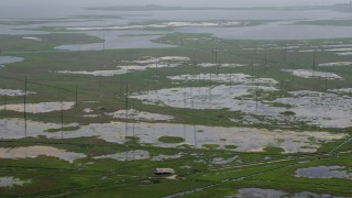 AX71_137 - 5K stock footage aerial video flying over poles, tide ponds, and marshland in Ocean County, New Jersey