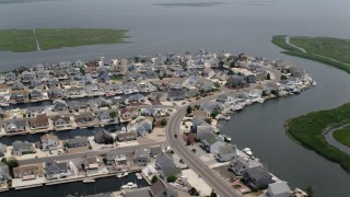 AX71_142 - 5K stock footage aerial video of waterfront homes and canals by Mill Creek in Manahawkin, New Jersey
