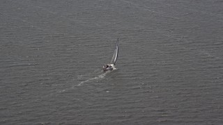 AX71_144 - 5K stock footage aerial video of a sailboat in Ocean County, New Jersey