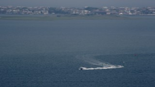 AX71_148 - 5K stock footage aerial video of a fishing boat cruising across Little Egg Harbor, New Jersey
