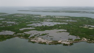 AX71_149 - 5K stock footage aerial video flying over Middle Island marshes in Little Egg Harbor, New Jersey