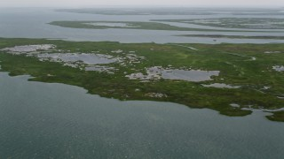 AX71_150 - 5K stock footage aerial video flying over Hither Island marshes in Little Egg Harbor, New Jersey