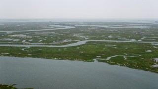 AX71_152 - 5K stock footage aerial video approaching and flying over wetlands in Ocean County, New Jersey