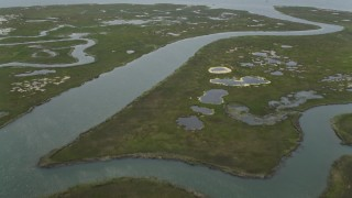 AX71_154 - 5K stock footage aerial video flying over a marsh island and Great Bay in Ocean County, New Jersey