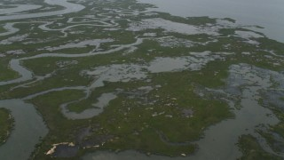 AX71_157 - 5K stock footage aerial video tilting from marshland to reveal Little Bay and Atlantic City skyline in New Jersey