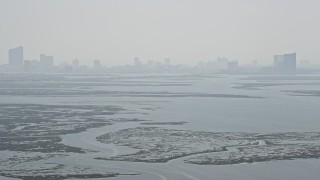 AX71_158 - 5K stock footage aerial video tilting from Little Bay to reveal marshland and Atlantic City skyline in New Jersey