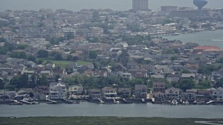 AX71_159 - 5K stock footage aerial video of coastal neighborhoods with docks in Brigantine, New Jersey
