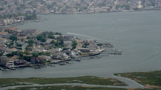 AX71_161 - 5K stock footage aerial video of bayfront homes with docks in Brigantine, New Jersey