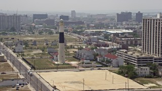 AX71_176 - 5K stock footage aerial video flying by Absecon Light and Pacific Avenue in Atlantic City, New Jersey