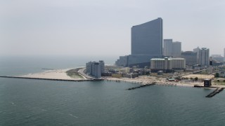 AX71_177 - 5K stock footage aerial video of a beachfront apartment complex and Revel Casino Hotel, Atlantic City, New Jersey