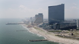 AX71_179 - 5K stock footage aerial video of Steel Pier, Revel Casino Hotel, and Showboat Atlantic City, New Jersey