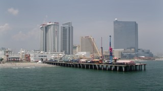 AX71_183 - 5K stock footage aerial video of Steel Pier and beachfront hotels in Atlantic City, New Jersey