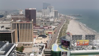 AX71_187 - 5K stock footage aerial video following the boardwalk past hotels in Atlantic City to approach Steel Pier, New Jersey