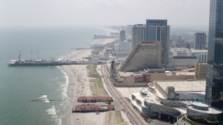 AX71_192 - 5K stock footage aerial video flying by Revel Hotel Casino to approach Steel Pier and Showboat Atlantic City, New Jersey