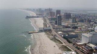 AX71_194 - 5K stock footage aerial video approaching Central Pier, Playground Pier, Atlantic City casino hotels, New Jersey