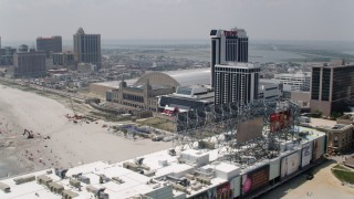 AX71_198 - 5K stock footage aerial video of Trump Plaza Hotel and Casino and Boardwalk Hall, Atlantic City, New Jersey