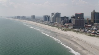 AX71_199 - 5K stock footage aerial video of beachside hotels in Atlantic City, New Jersey