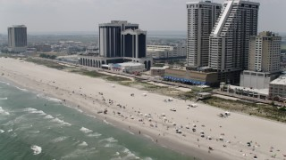 AX71_201 - 5K stock footage aerial video of sunbathers on the beach in Atlantic City, New Jersey