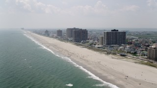 AX71_203 - 5K stock footage aerial video of beachfront condominium high-rises in Atlantic City, New Jersey