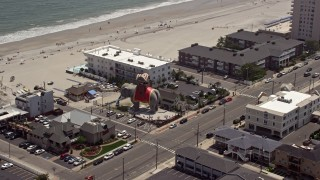 AX71_209E - 5K stock footage aerial video orbiting Lucy the Margate Elephant, Margate City, New Jersey