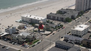 AX71_210 - 5K stock footage aerial video orbiting Lucy the Margate Elephant in Margate City, New Jersey