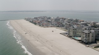 AX71_215 - 5K stock footage aerial video of upscale beachfront homes in Longport, New Jersey