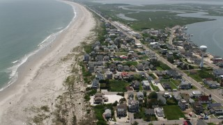 AX71_236 - 5K stock footage aerial video flying over beachfront homes by RV park in Strathmere, New Jersey