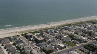 AX71_249 - 5K stock footage aerial video of beachfront neighborhoods in Avalon, New Jersey