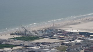AX71_259 - 5K stock footage aerial video of roller coasters at Surfside Pier in North Wildwood, New Jersey
