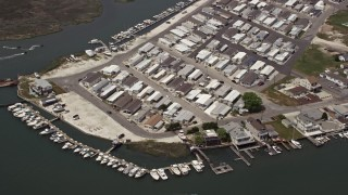 AX71_262 - 5K stock footage aerial video of a waterfront mobile home park in Wildwood, New Jersey
