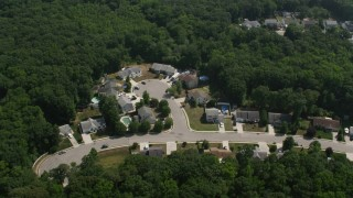 AX72_001 - 5K stock footage aerial video of suburban homes in Cape May, New Jersey