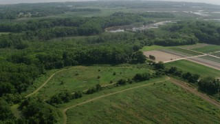 AX72_004 - 5K stock footage aerial video flying over farmland and marshes in Cape May, New Jersey