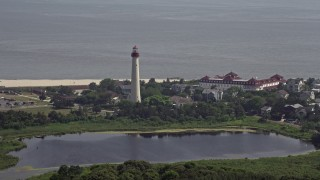 AX72_006 - 5K stock footage aerial video of the Cape May Lighthouse and Lighthouse Pond, New Jersey