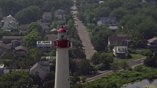 AX72_009 - 5K stock footage aerial video of the top of Cape May Lighthouse and coastal neighborhood, New Jersey