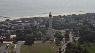 AX72_010 - 5K stock footage aerial video of Cape May Lighthouse and coastal neighborhoods by the beach, New Jersey