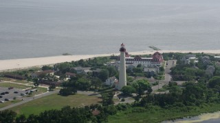 AX72_011 - 5K stock footage aerial video orbiting the Cape May Lighthouse, New Jersey