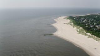 AX72_013 - 5K stock footage aerial video of the beach and Delaware Bay in Cape May, New Jersey