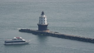 AX72_019 - 5K stock footage aerial video of a ferry by the Harbor of Refuge Light, Delaware