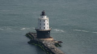 AX72_020 - 5K stock footage aerial video flying by the Harbor of Refuge Light, Delaware