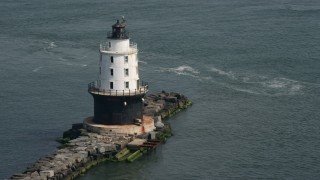 AX72_021 - 5K stock footage aerial video orbiting the Harbor of Refuge Light, Delaware
