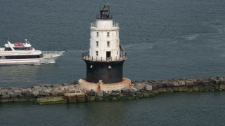 AX72_022 - 5K stock footage aerial video orbiting the Harbor of Refuge Light, Delaware, and reveal a ferry