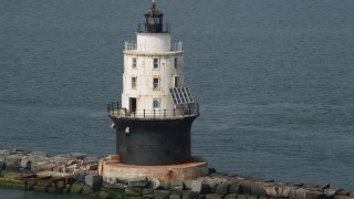 AX72_023 - 5K stock footage aerial video orbiting of the Harbor of Refuge Light, Delaware