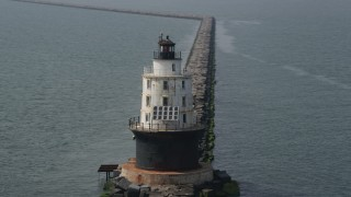 AX72_024 - 5K stock footage aerial video orbiting the Harbor of Refuge Light, Delaware