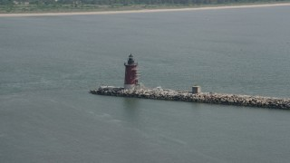 AX72_027 - 5K stock footage aerial video of Delaware Breakwater East End Light in Delaware Bay